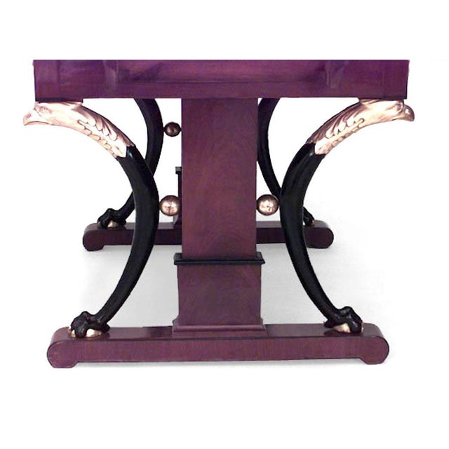 Baltic neoclassic parcel-gilt, ebonized and mahogany sofa table with two drop leaves over a frieze drawer on eagle headed...