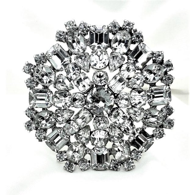 Large, dazzling c.1950s rhodium-plated brooch prong set with large clear, round, emerald-cut, pear-shape and oval faceted...