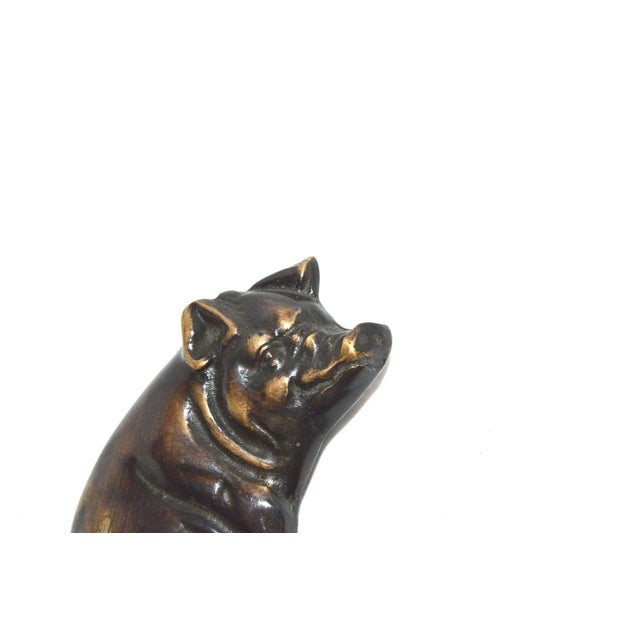 A whimsical door knocker featuring a happy pig. Mounts using 2 simple screws, which are included. Works well with a good...