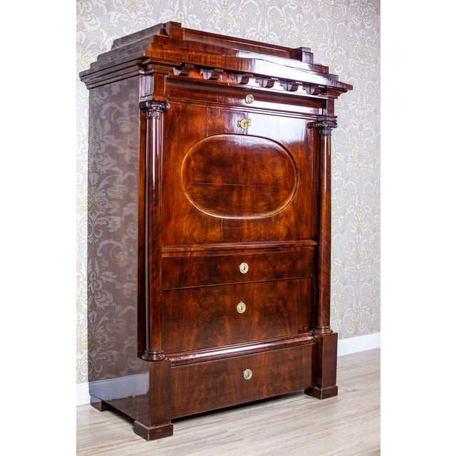 We present you a piece of furniture in the Biedermeier style, made of softwood veneered with mahogany. It is circa 1840....