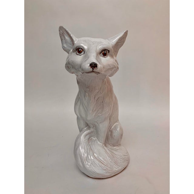 Large and heavy white arctic or snow fox sculpture ca. 1960s made from terra cotta. It features a heavily textured fur and...