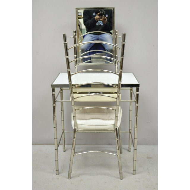 Hollywood Regency Faux Bamboo Metal Vanity Chair & Small Vanity Table with Mirror. Item features silver chrome frame,...