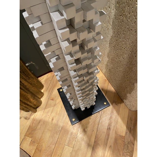 Unique vintage floor sculpture of stacked wood, painted. Steel base with brass feet. Texture and depth to this undulating...