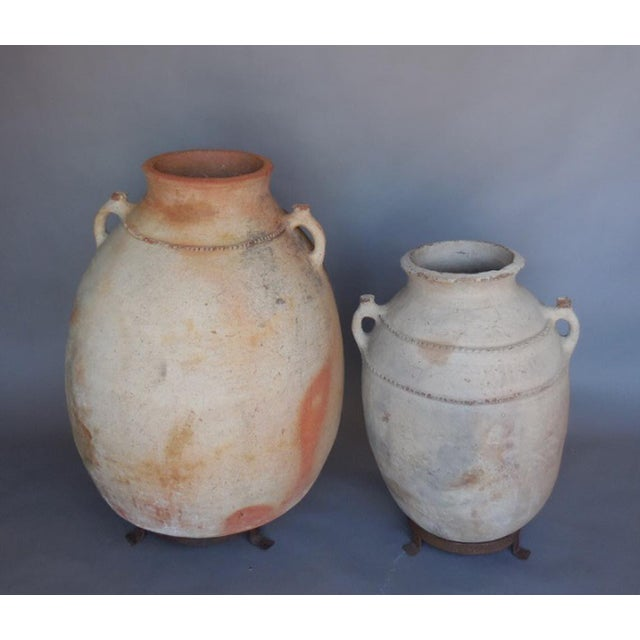 The one on the right is sold. 19th century unglazed terra cotta pot with pie crust detail. A few small holes. Sold...