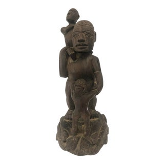 Hand Carved African Sculpture of a Man With Two Children For Sale
