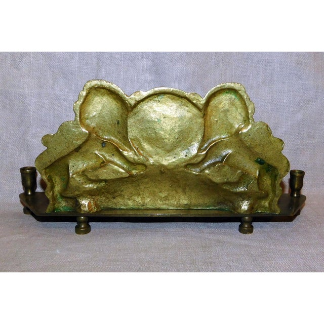 Stunning antique brass menorah featuring the lions which are the symbol of the Tribe of Judah flanking the Star of David....