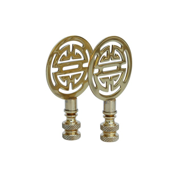 A pair of Chinoiserie style solid brass lamp finials. Fits a standard size lamp harp. Measurements per finial. We have...