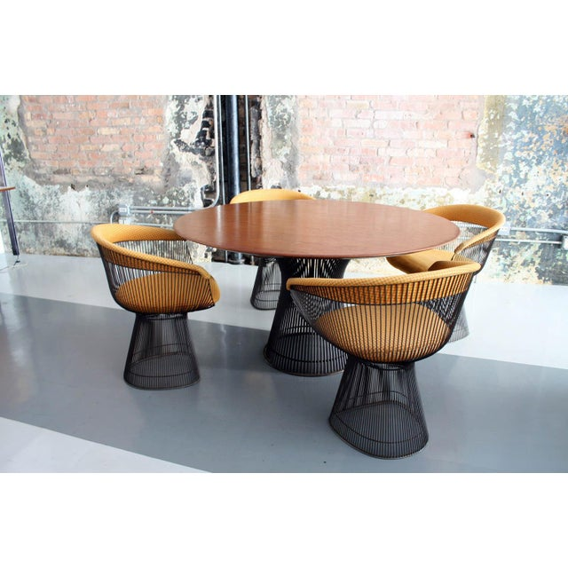 Original dining set by Warren Platner for Knoll. This set is in wonderful original condition. The walnut top of the dining...