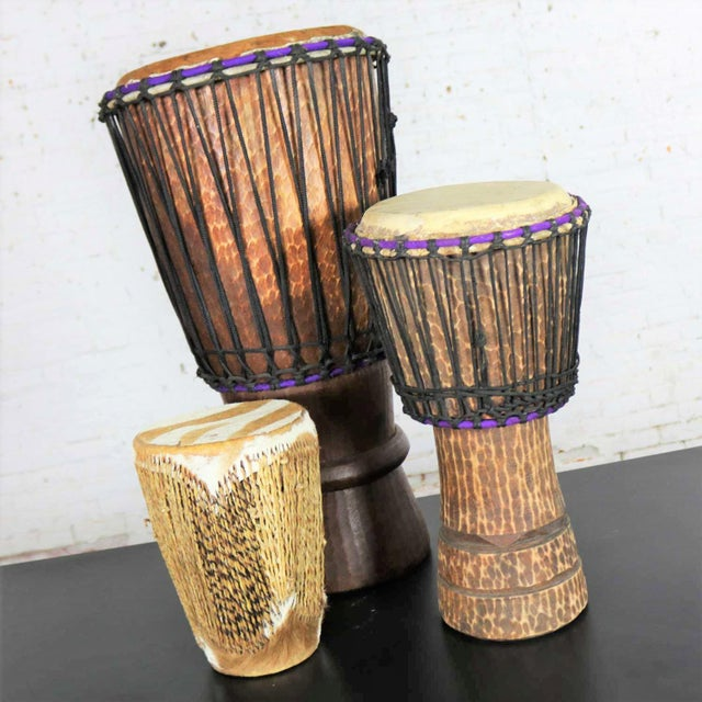 Intriguing trio of differing size tribal drums of carved wood and animal hide. They are in wonderful condition. Priced as...