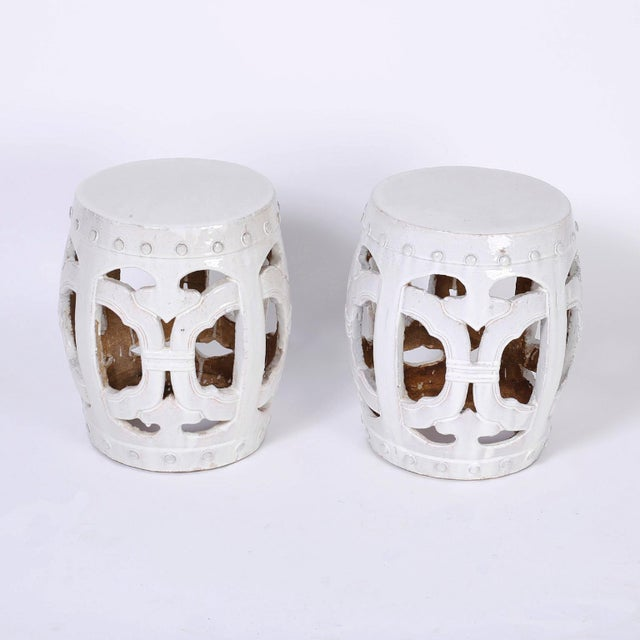 Pair of terracotta Chinese garden seats with an alluring translucent white celadon glaze over a Classic chinoiserie form.