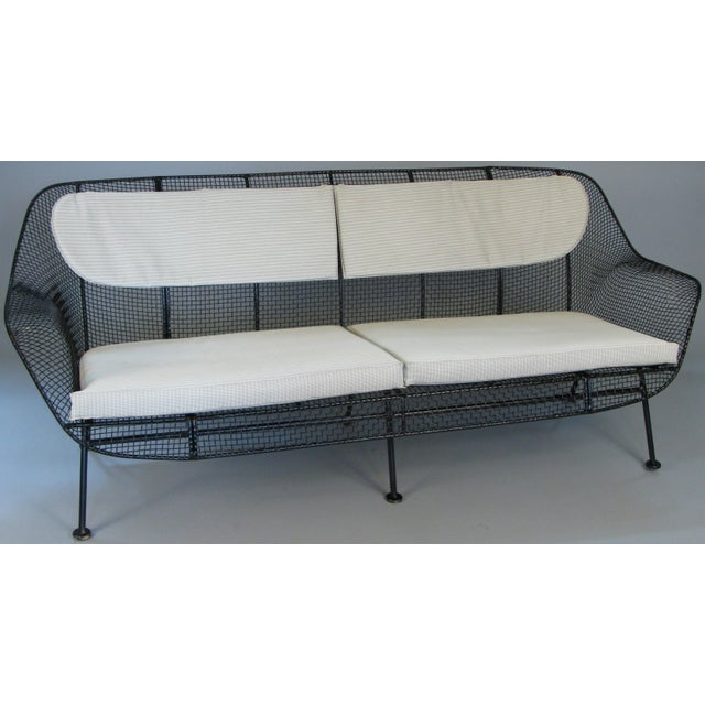 A rare example of Russell Woodard's iconic sculptura long sofa in wrought iron and woven steel mesh. Beautiful proportions...