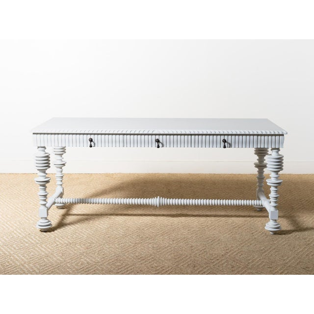 Large spool-turned mahogany desk Hand applied White finish Three drawers with metal pulls