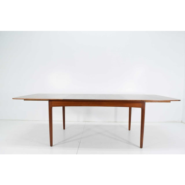 This table was purchased by the original owner in the 1950s as part of a dining set which is shown in the photos. The...