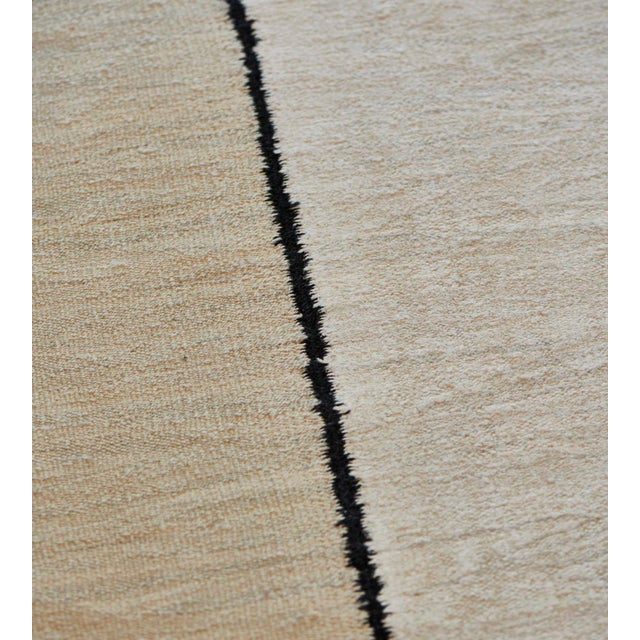 This vintage Deco rug features a main field with five broad vertical bands of sandy-yellow and shaded ivory divided by a...