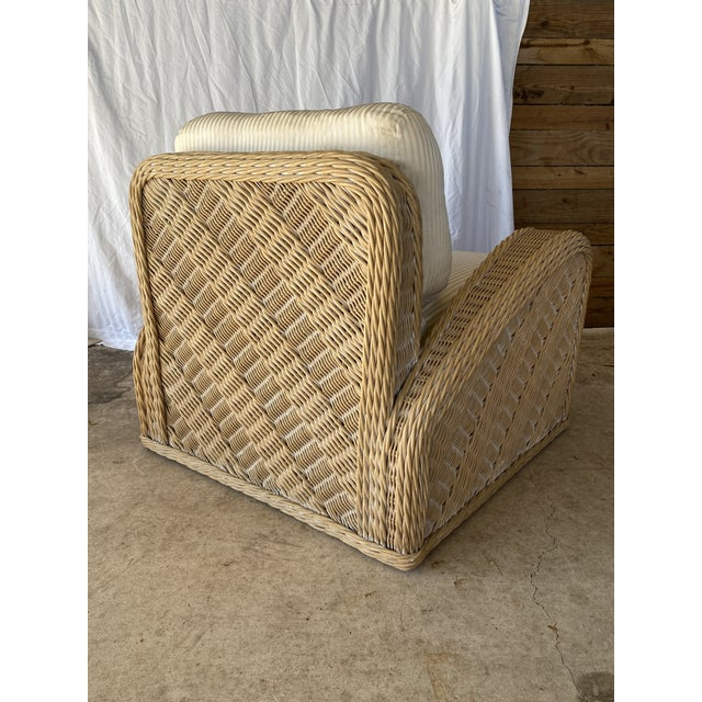 This coastal large wicker braid upholstered chair is super comfy and large enough to curl up in. The upholstery might be...