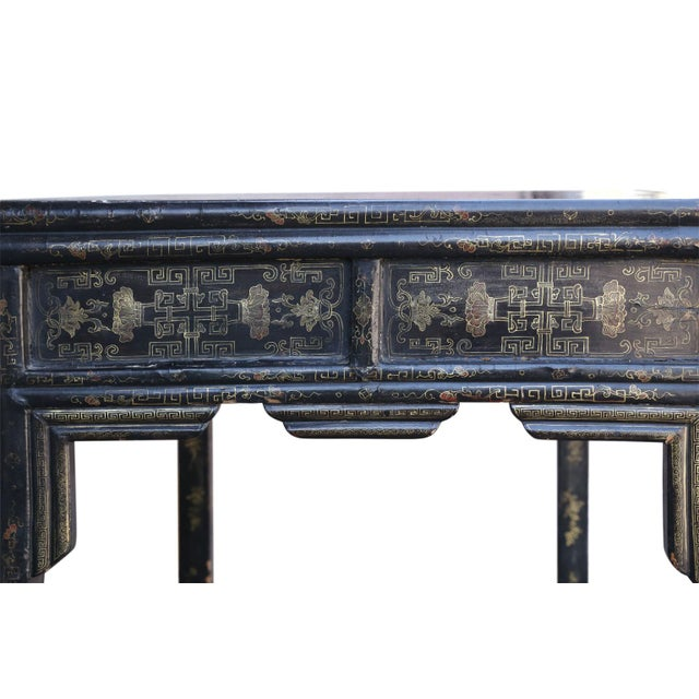 Antique Chinese black lacquer table (circa 1880-1920) constructed using mortise and tenon joints as well as nails. Signs...