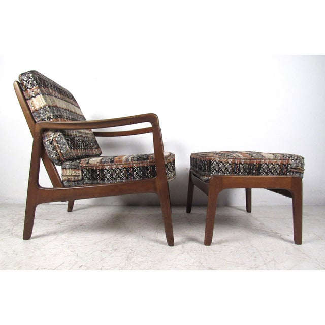 This slat back walnut lounge chair by Ole Wanscher for John Stuart comes complete with ottoman and flannel style tweed...