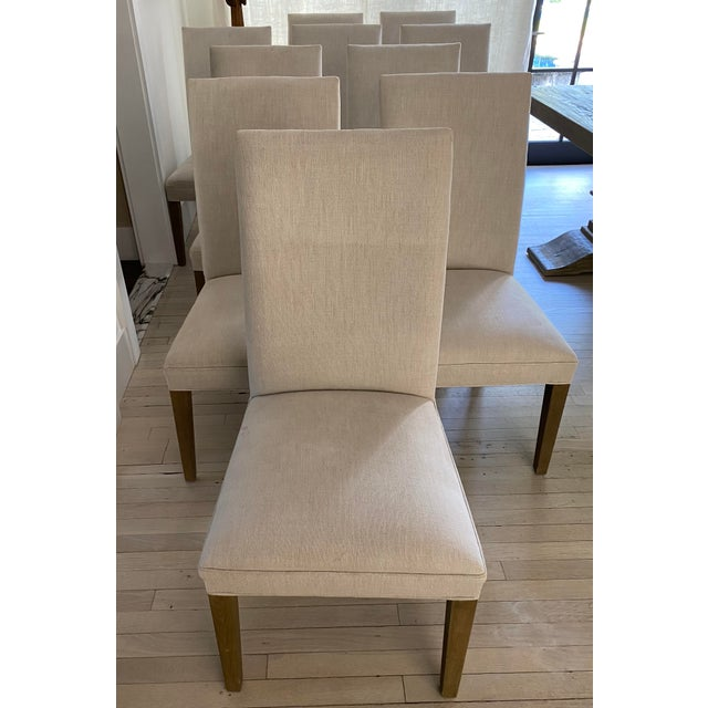 Set of ten Restoration Hardware Hudson Parsons dining chairs. The contemporary style, good look and confortable padding...