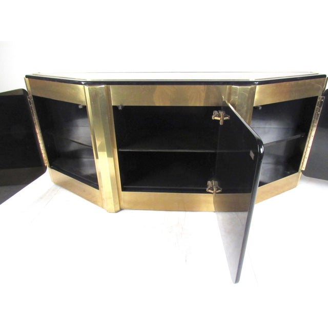 This elegant vintage modern cabinet by Bernhard Rohne for Mastercraft features Tree of Life design, brass finish, and...