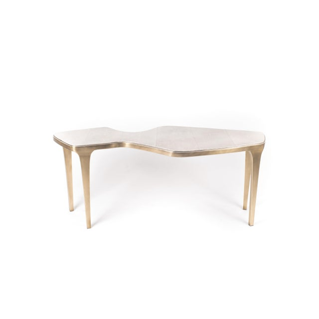 The cosmos nesting coffee tables are both Minimalist and dramatic. The top is inlaid in cream shagreen in the large size,...