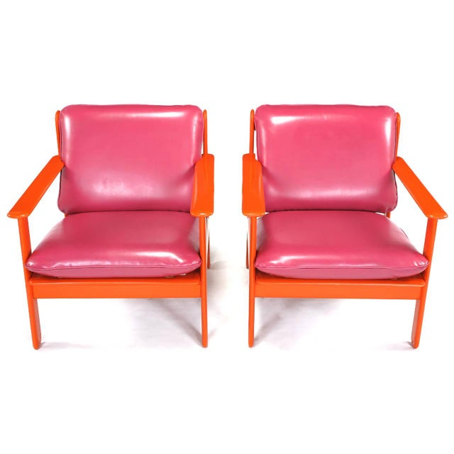 Colorful pair of Italian lounge chairs with persimmon orange lacquer over wood frames and magenta red-pink simulated...