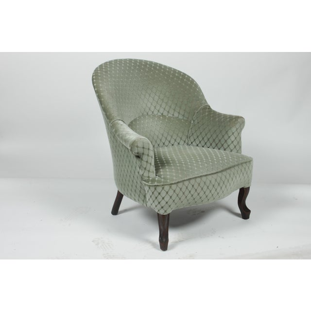 1890s Victorian-Style ladies slipper chair featuring a slanted rounded back for ladies bustles, short arms, cabriole...