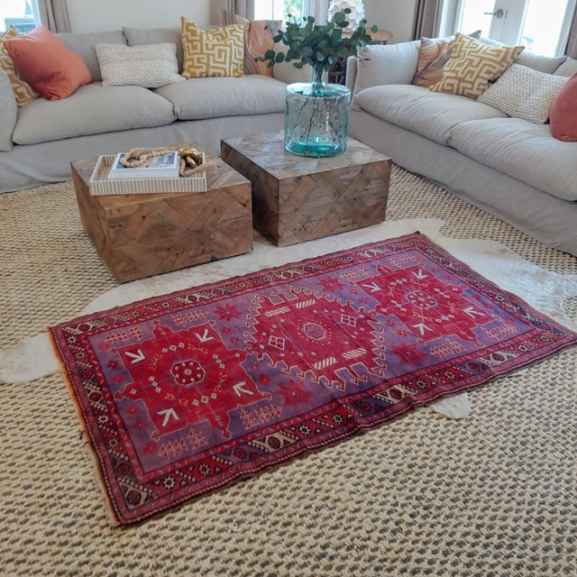 Gorgeous, vintage Heriz Rug featuring three large medallions of red flanked by 2 pink medallions. The main body of the rug...
