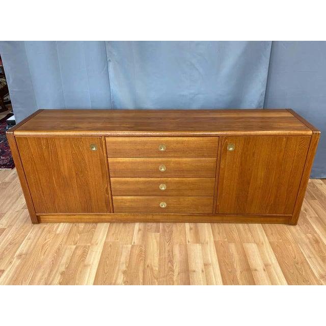 A large 1970s Scandinavian Modern Captain Line teak credenza or dresser by D-Scan. Expansive piece offers ample storage,...