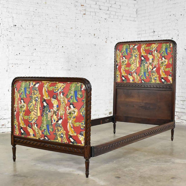 Handsome antique French carved walnut twin bed upholstered in a contemporary Asian figural fabric. It is in fabulous...