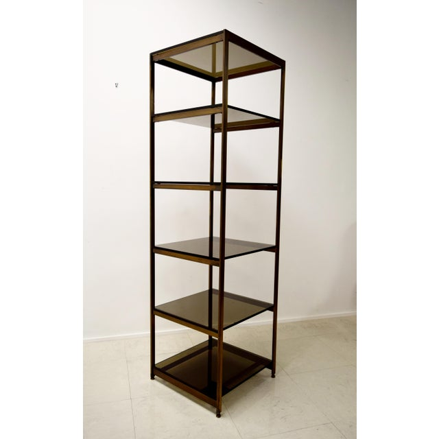 A lovely and very well made brass and smoked glass etagere / book shelf. This piece has a lovely frame featuring welded,...