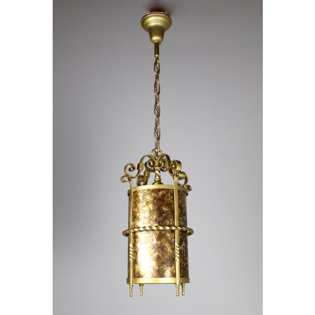 This 1920s mica cylinder gives off the most beautiful glow. Lovely twisted brass details.
