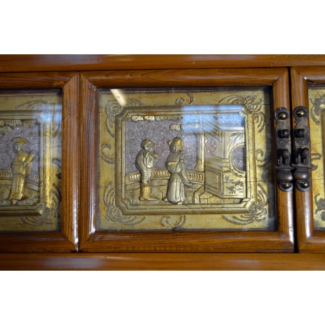 Black Early 20th Century Chinese Lacquered Armoire With Gilt Carved Warrior Motifs For Sale - Image 8 of 13