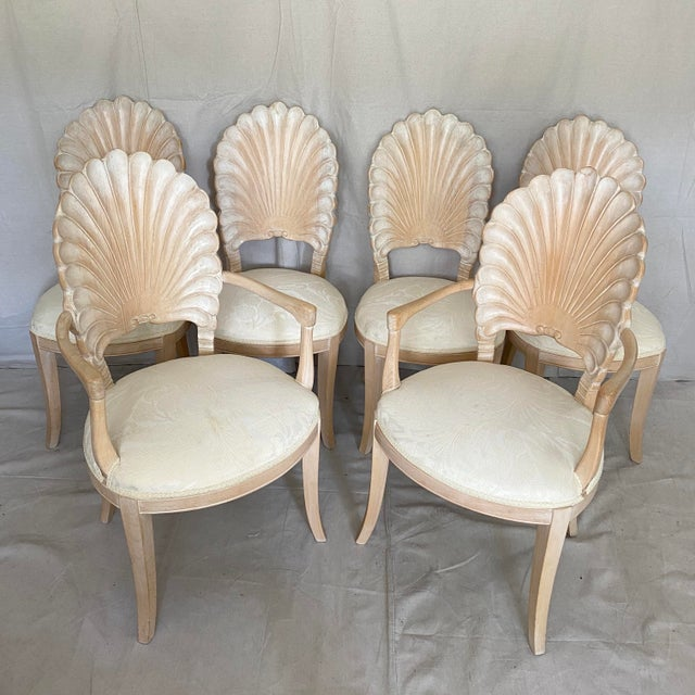 Vintage set of 6 shell dining chairs. Carved wood shell backs with upholstered seats. Two arm chairs, four side chairs....