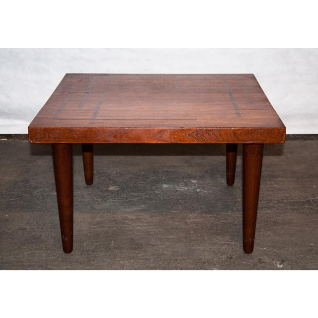 A very rare and finely crafted rosewood and teak side table designed and crafted by J. Schmidt. The abstract rosewood...