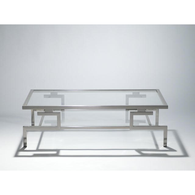 This table's beautiful, polished nickel base and feet reflect the Chinese-inspired design that dominated many of Guy...