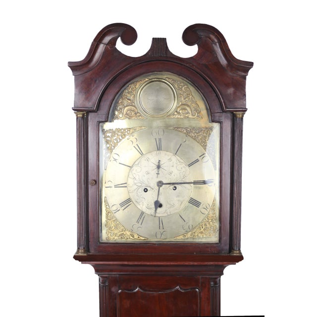 An attractive grandfather clock in mahogany with decorated brass face. Made in Scotland 1780 by clocker-maker Robert Knox.