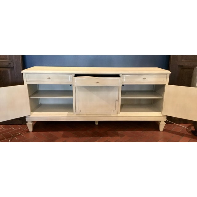 Chic transitional three door soft ivory server, Lillian August for Hickory White, three doors each revealing an adjustable...