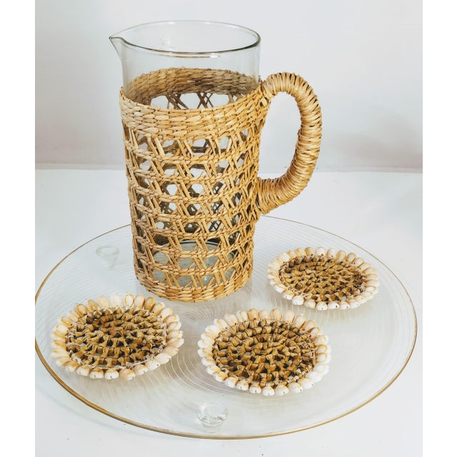 Rattan wrapped cocktail Pitcher. Super trendy item perfect for summer time. Great condition. Item sold as for pitcher...
