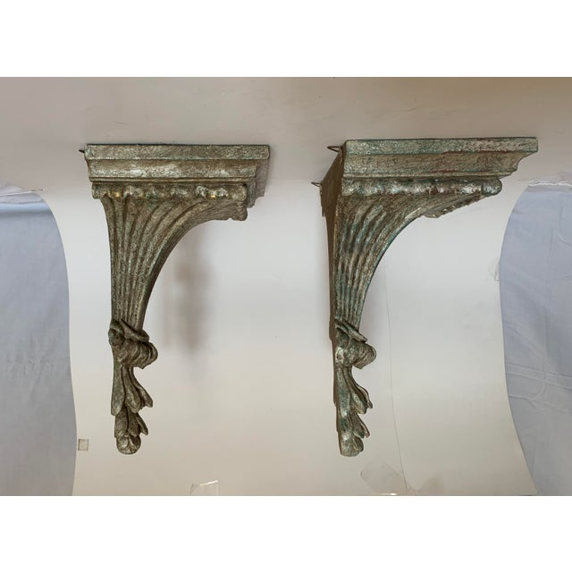 Two Italian carved and painted wood corbels with rectangular shelf. Fluted and scalloped top descending to beautifully...