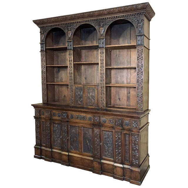 19th Century Renaissance Bookcase combines a plethora of classically themed bas relief motifs hand-carved from the bold...