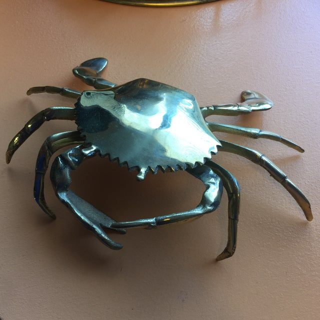 This beautiful brass crab ashtray can be also used as a small trinket box. The crab's body opens and closes like a box....