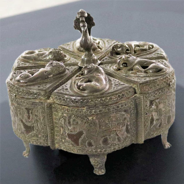 Gorgeous antique India pierced silver overlay on wood spice box. It has six compartments and is decorated with lions, and...