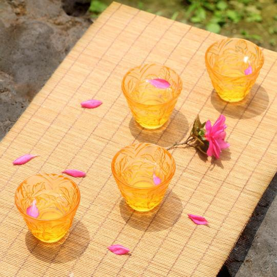 This set of four crystal sake glasses adds an elegant floral touch of spring to any occasion. Color: Light Amber Material:...