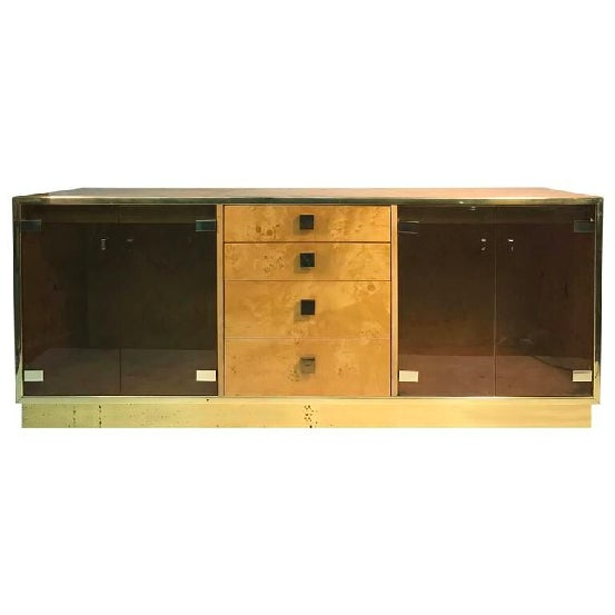 A magnificent burl wood sideboard, credenza, or cabinet with set of double glass doors, four drawers, and interior...