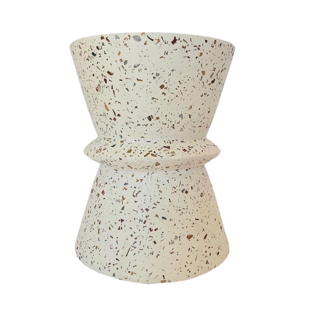 This Terrazzo end table is perfect for making a statement along side any chair, sofa, or bed. A work of art all on its own...