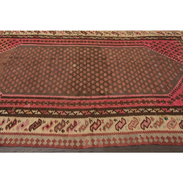 Hand-woven Vintage Persian Kilim with a colorful geometric design. This piece has great detailing and would be the perfect...