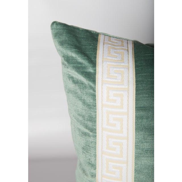 Pair of custom seafoam green velvet pillows with cream-and-ivory Greek key tape on fronts. Solid green velvet backs,...