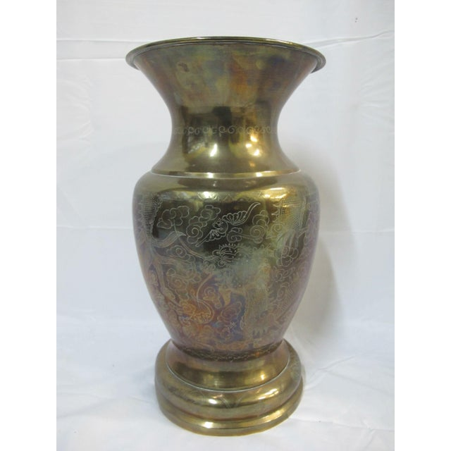"""Large brass urn with finely etched phoenix and dragon design. Measures 14 3/4"""" tall x 8"""". Very good Condition with one..."""