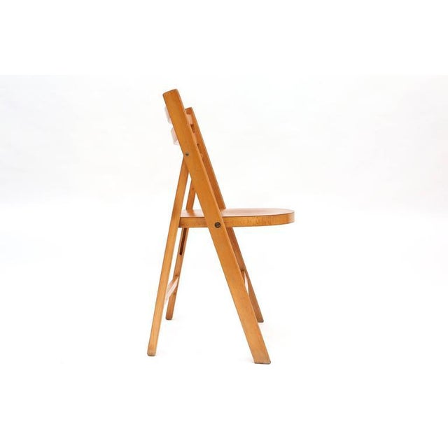 Fabulous folding chair beech brass, Dutch, 1950s. Stackable. 100 pieces available!!! Price per piece.
