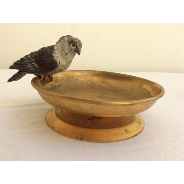 Antique Vienna Bronze Pigeon mounted to small Gilt brass Bowl. Bends and wear on item.